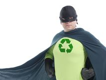 Eco superhero. With green recycle arrow symbol on chest posing confidently over white background - recycle concept Royalty Free Stock Images