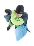 Eco superhero and household garbage. Eco superhero holding blue plastic bag full of domestic trash pointing his hand up standing on white background - waste Stock Photos