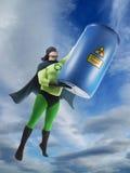 Eco superhero and hazardous waste. Eco superhero taking away blue container containing hazardous waste high from Earth stock photography