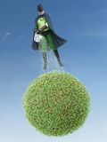 Eco superhero and green planet Royalty Free Stock Photography
