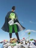 Eco superhero and green plantlet Stock Photography