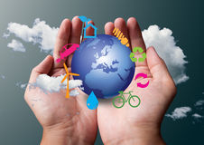 Eco symbol in hands. Eco symbol around the earth in two hand Royalty Free Stock Image