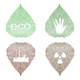 Eco symbols on openwork leaves Royalty Free Stock Images