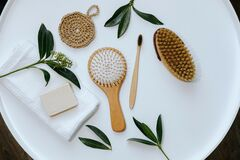 Free Eco Tools For Spa Treatments And Body And Hair Care. Sea Salt, Face Serum, Soap, Hairbrush. Ecology Concept Stock Photos - 190055943