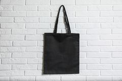 Free Eco Tote Bag Hanging On White Brick Wall. Royalty Free Stock Photo - 137977345