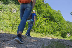 Eco tourism and healthy lifestyle concept. Young hiker girl end boy with backpack. Active hikers Royalty Free Stock Photos