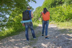 Eco tourism and healthy lifestyle concept. Young hiker girl end boy with backpack. Active hikers Royalty Free Stock Images