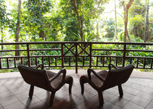 Eco tourism, resort patio with natural jungle view. A photograph showing the beautiful natural landscape view from the patio balcony of a tropical holiday resort Royalty Free Stock Images