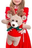 Eco toys, the deer soft toy in the christmas girls hands on the white background stock images