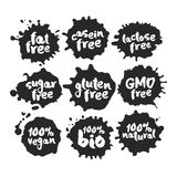 Eco Vegan Food Labels Set on Black Inkblots. Calligraphy hand written labels with eco vegan food words and phrases on black inblots. Isolated on white. Clipping vector illustration