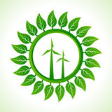 Eco wind mill inside the leaf background Royalty Free Stock Photos