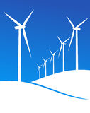 Eco windmills illustration. Group of Windmills white silhouettes on blue background. Vector available Royalty Free Stock Photos
