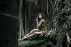Eco woman sitting on the trunk Royalty Free Stock Photo