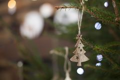 Eco wooden toys on a lively green Christmas tree new year Royalty Free Stock Images