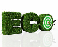 Eco word composed by grass with a dartboard and darts Royalty Free Stock Image