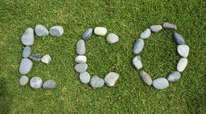 ECO-Wort vereinbart unter Verwendung des Kieselsteins. Stockbild