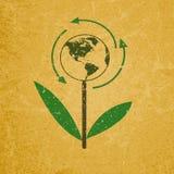 Eco-Zeichen auf leerer Schmutzrecyclingpapierbeschaffenheit Lizenzfreie Stockfotografie