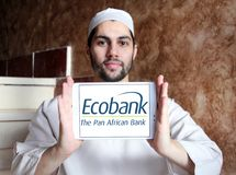 Ecobank Transnational logo. Logo of Ecobank on samsung tablet holded by arab muslim man. Ecobank Transnational ETI, is a pan African banking conglomerate, with Stock Photos