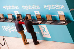 Visitor register at registration desk Royalty Free Stock Images