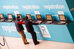 Visitor register at registration desk Royalty Free Stock Images