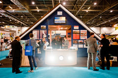 Businessmen, exhibitors and potential clients at b. London, UK - 6 March 2013: Avonside stand during Ecobuild 2013 at Excel, the worlds biggest event for Royalty Free Stock Images