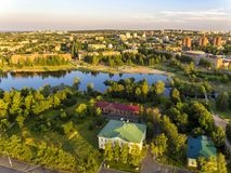 Ecofriendly city and river from bird high in summer. Ecofriendly green city and river from bird high in summer evening. Shot from drone stock photography