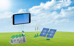 Ecofriendly concept. Green factory, wind turbine and solar panel connected to smartphone royalty free stock image