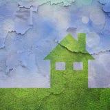 Ecohuis met gebarsten textuurachtergrond Stock Afbeelding