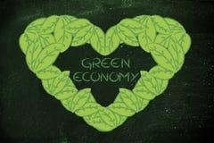 Ecología y economía verde, corazón hecho de hojas Fotos de archivo libres de regalías