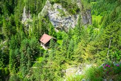 Ecolog mountain hut as seen from high above on the `Astragalus` via ferrata route, a popular sport attraction in Bicaz Gorge. Cheile Bicazului, Romania, on a royalty free stock images