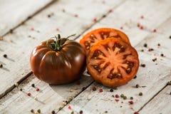 Ecologic black Tomato stock photography