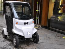 Ecologic car. Black and white ecologic , electric car on the streets of Florence, Italy Royalty Free Stock Photos