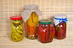 Ecologic chilli peppers paprika preserved  glass pots group Stock Images