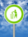 Ecologic sign. Ecologic traffic sign - man throwing trash into a basket Stock Photo