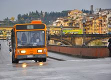 Ecologic transportation bus in Italy. Ecologic mini bus  in Florence city,  Italy. Public transportation in the streets of a touristic city Royalty Free Stock Image