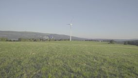 Ecologic Windmill at meadow stock footage