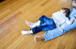Ecological bamboo hardwood. Little girl sleeping at hardwood floor Royalty Free Stock Photo