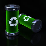 Ecological batteries. 3d green batteries on a black reflective floor Stock Image