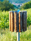 Ecological bin. In front of a field Royalty Free Stock Photography