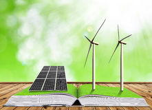 Ecological book with solar panel and wind turbines. Stock Images