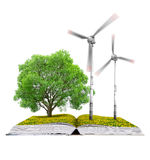 Ecological book with tree and wind turbines Stock Images