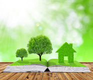 Ecological book with trees and house Stock Photo