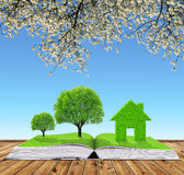 Ecological book with trees and house Stock Photography