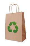 Ecological brown paper bag with recycling symbol Stock Images
