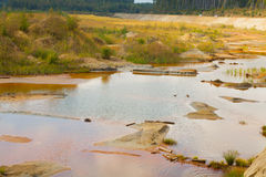 Ecological catastrophy in mud sand quarry Stock Images