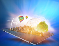 Ecological city with clouds and windmills on the Stock Images