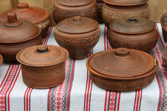 Ecological clay pottery ceramics sold in market Stock Image