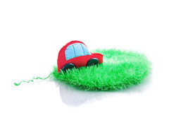 Ecological clean concept car on green grass. Clean ecology concept car on green grass. Isolated on white Royalty Free Stock Images