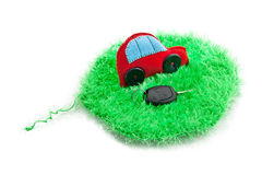 Ecological clean concept car on green grass. Clean ecology concept car and key on green grass. Isolated on white Royalty Free Stock Image
