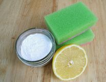 Ecological cleaning. Two green sponges, glass bowl with bicarbonate of soda and half on a lemon Royalty Free Stock Image